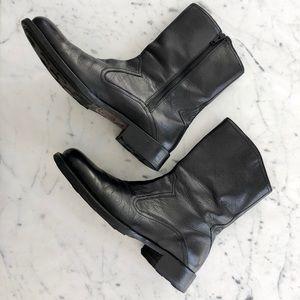 Men's black Cole Haan Chelsea boots.